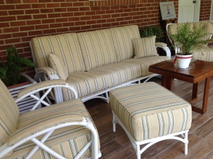 Rattan furniture inherited from husband's parents with replaced cushions and upholstery. Time to enjoy the backporch remodel. Copyright 2016. Linda Martin Andersen