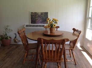 New tile flooring and heat/air wall mount unit. Grandmother's kitchen table and chairs. Copyright 2016. Linda Martin Andersen