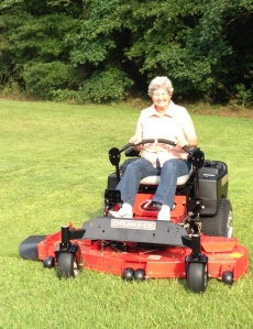 Gayle Martin on a zero-turn mower. Copyright 2014. Linda Andersen